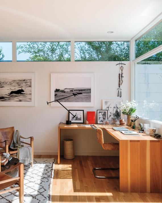 The office doubles as a guest room, thanks to a discreet Murphy bed and pull-out side tables in the wall unit. Lind built the L-shaped desk himself to allow for the footprint of the bed. When family visits from Canada, all the couple has to do is move the two Kaare Klint midcentury Danish safari chairs and the wooden table.