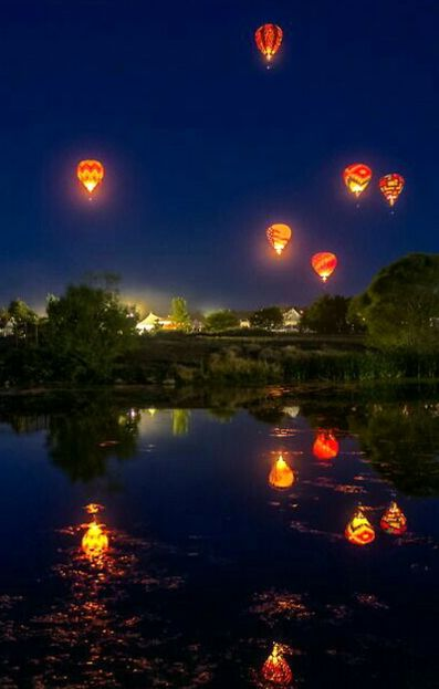 floating balloons in the nite sky