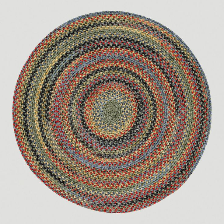 This is way too expensive ($309), but something like this would be perfect for the classroom round rug.   Songbird Round Braided Rug, Parakeet | World Market
