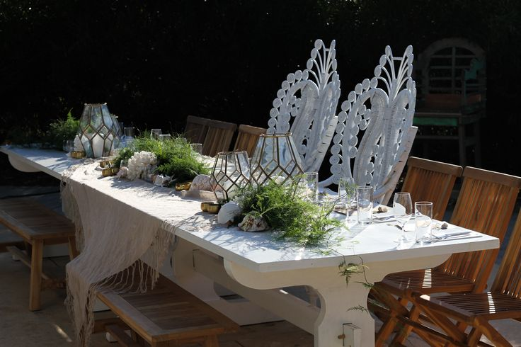 Bridal table featuring Empire Events Peacock Chairs.