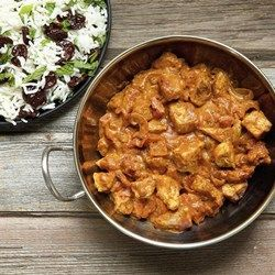 Curried Coconut Chicken - 1lb chicken, mote curry, added ginger and cayenne, no tomato sauce.  Served with rice cauliflower.  Yummy!