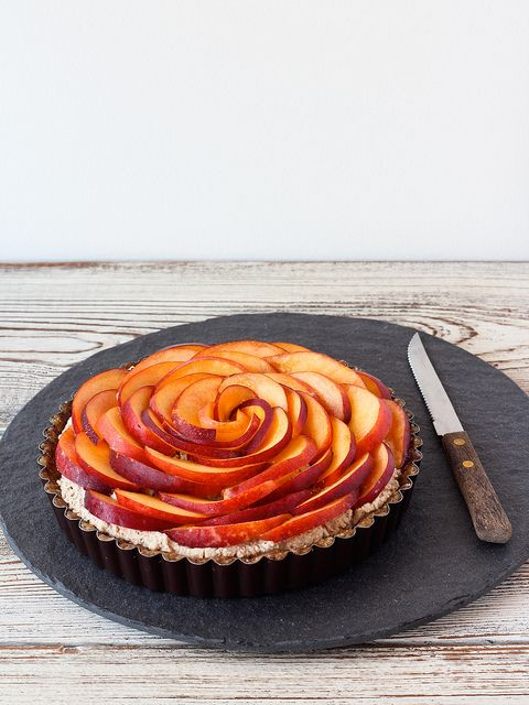 Raw nectarine and cardamom cream tart by Ashlae  1  cup raw almonds  1/2 cup raw cashews  1 1/2 cups raw walnuts  12-14 medjool dates, pitted and divided  1/2 cup raw nut milk (or water)1 vanilla bean, split and scraped  1/2 tsp ground cardamom  Pinch of fine sea salt  2-3 nectarines, halved, pitted and sliced--- Wow!