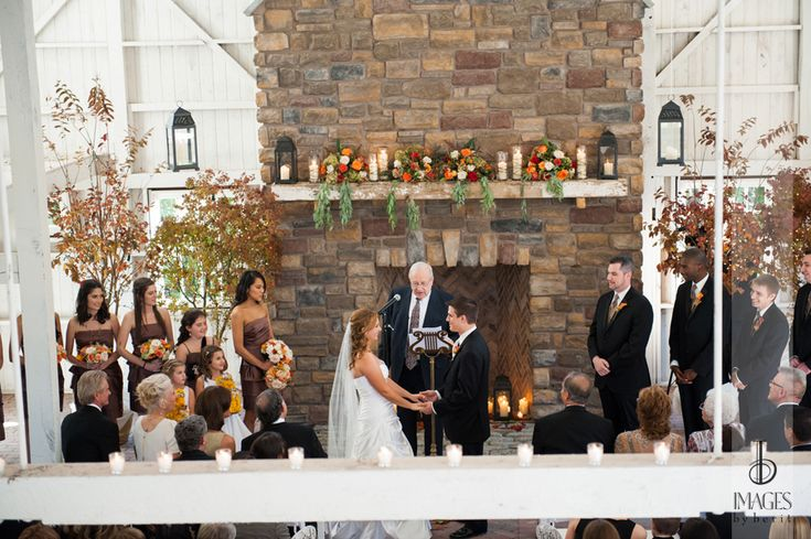 Morgan and Craig were married in the barn/chapel at The Ashford Estate.  They brought in trees that were re-purposed at the reception to flank their sweetheart table.  Craig's parents took the tress back to their house for planting afterwards.  Morgan's flower girls carried teddy bears made from button mums.  Photo courtesy of Images by Berit