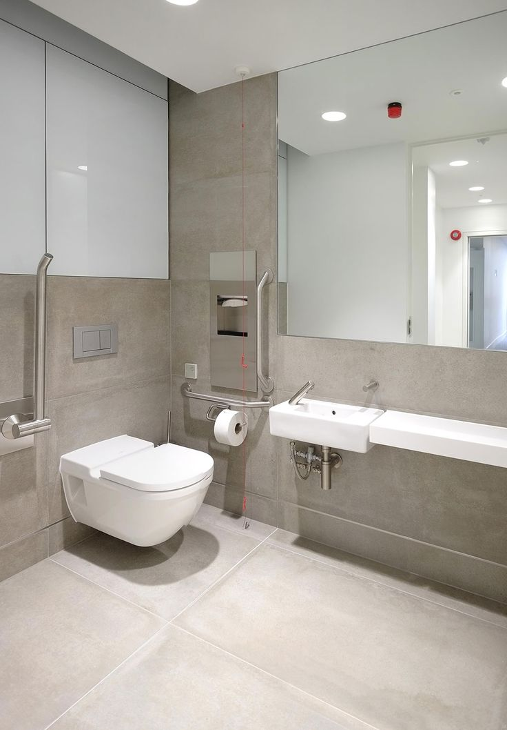 A very contemporary WC at an office project. Featuring concrete effect tiles from the Synthetic range.