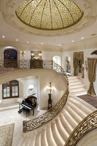 Elegant Grand Staircase and lighting!