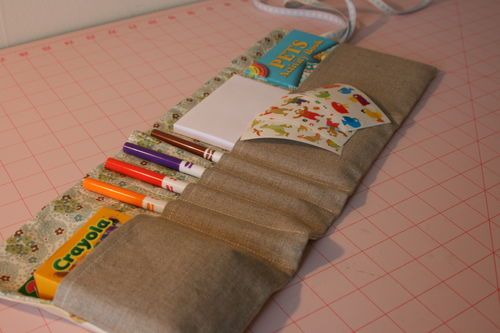 "Here's ""a nifty little pattern for a wrap which holds all kinds of favorite art supplies"" by bread and buttons. ""Each wrap can hold a notepad, crayons, pens and a Dover little book or any small sized activity book.""                                                                                                                                                                                 More"