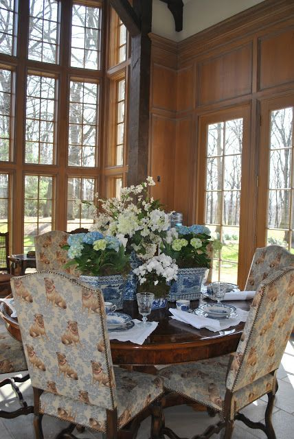 The Enchanted Home, round table with high back wing chairs & floor to ceiling windows