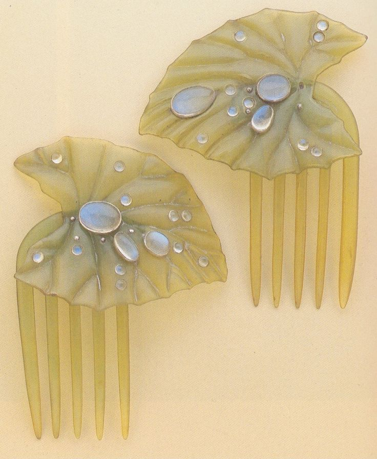 Green-tinted horn lily-pad hair combs with moonstone dewdrops, by Ella Naper, circa 1900.
