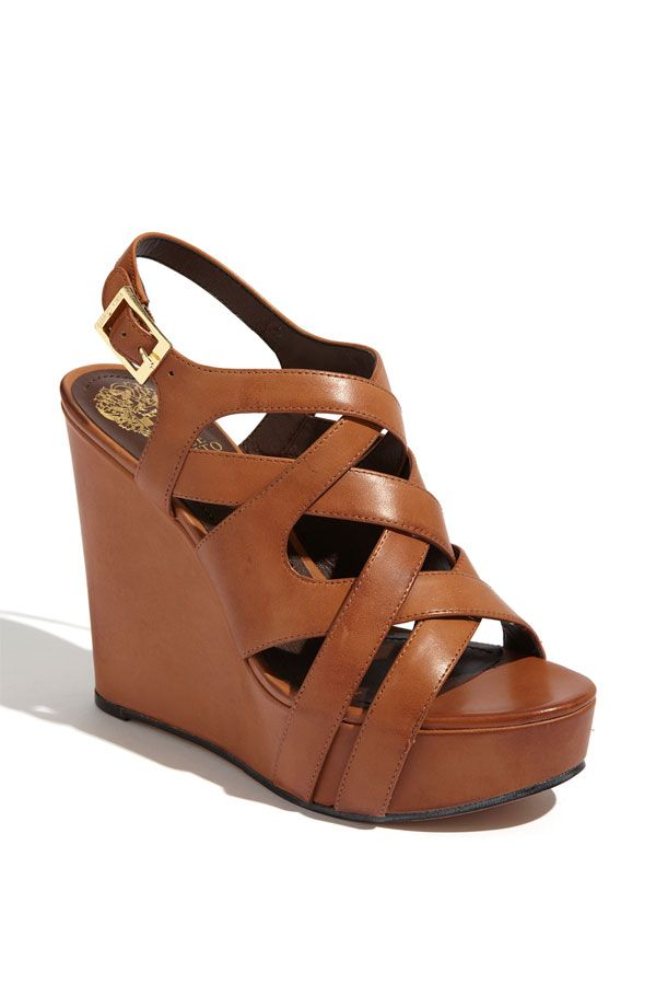 A wrapped wedge lends smooth height to a strappy sandal with logo-embossed  hardware. Color(s): fudge, overcast. Style Name: Vince Camuto &