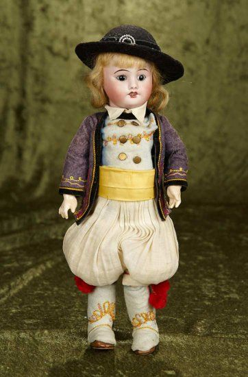 "13"" French bisque bebe by DFBJ in original Brittany costume~~~Bisque socket head, black glass inset eyes, painted features, open mouth, four teeth, blonde mohair wig, French composition and wooden fully-jointed body. Marks: SFBJ Paris. SFBJ, circa 1915, the doll wears elaborate original antique costume of Brittany with embroidered detail on leggings, sleeves and vest, with hat."