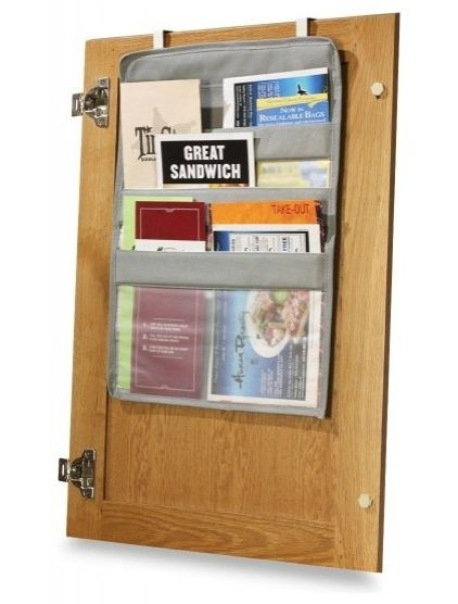 Over the cabinet door, organize coupons, take-out menus, etc.