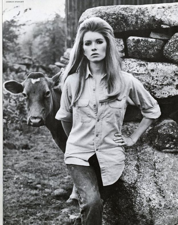 Martha Stewart. For some reason I love this photo... Maybe it's the huge teased hair and cow combo.
