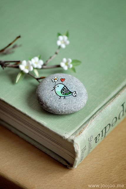 painted bird on stone