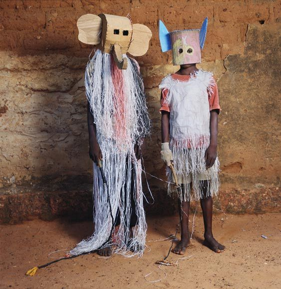 From National Geographic Burkina Faso An elephant and a bat pose at the Dodo Masquerade in Burkina Faso, an event where children don masks, sing, and dance under a full moon. Photograph by Phyllis Galembo