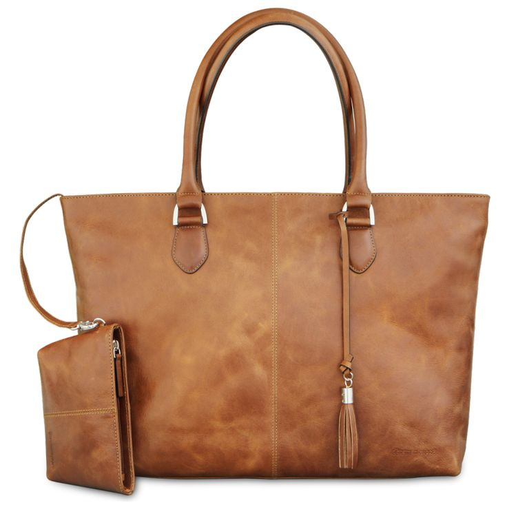 "'Sophie Amalienborg' is an elegant and classic tote designed to be eternally useful and age beautifully. Made of soft, sleek full grain Leather, it features an internal padded section to hold a laptop up to 15""."