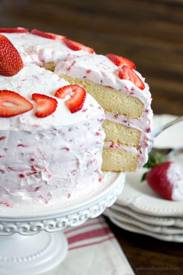 Vanilla pound cake is topped with light and fluffy whipped cream frosting, overflowing with fresh strawberries. It's the best Strawberry Shortcake you've ever had!