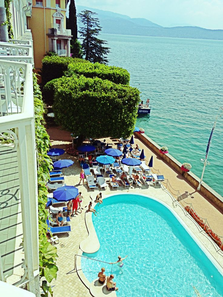 Balconies overlooking our swimmingpool #lagodigarda #lakegarda #gardasee