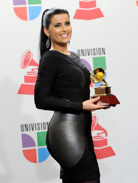 Nelly Furtado Photos - The 11th Annual Latin GRAMMY Awards - Press Room - Zimbio
