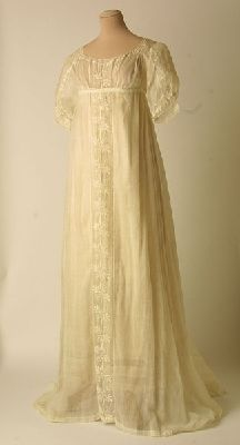 A period white muslin gown circa 1810. I think the center front embroidery would be a beautiful way to embellish a solid colored ground.