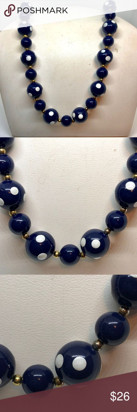 """Polka Dot Beaded Necklace True vintage polka dot beaded necklace. Navy blue plastic beads with pained white circle polka dots. Smaller navy beads are set in between the painted ones. Gold tone spacers separate each bead. Clasp is a hook closure. Beads are 13mm and 10mm in size. Necklace is 24"""".  Some white paint had chipped, in good vintage condition. Vintage Jewelry Necklaces"""