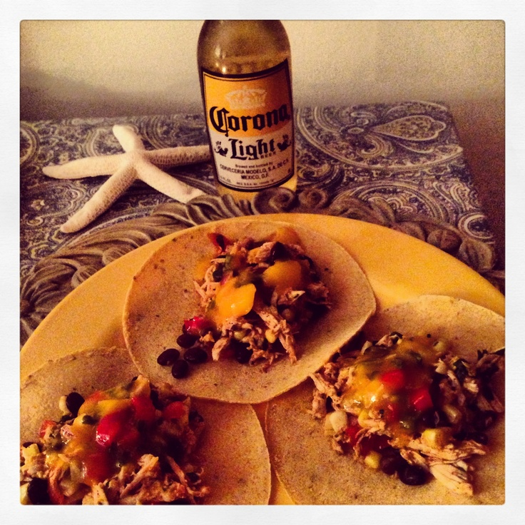 Cilantro lime chicken tacos with mango salsa http://www.rachaelraymag ...