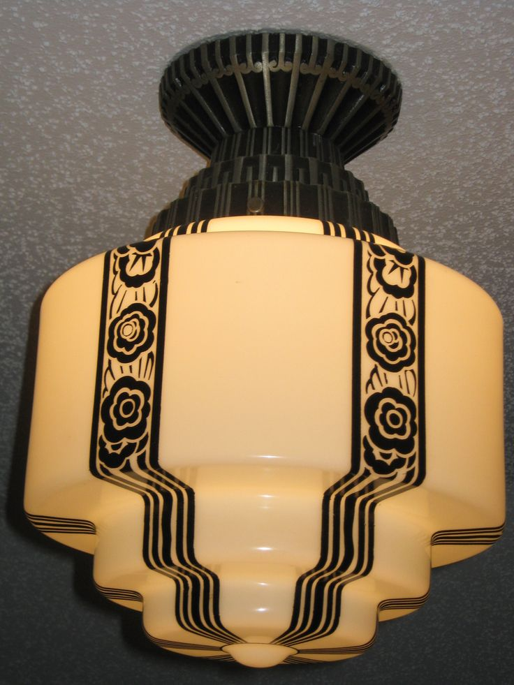 I would love to have this style house. It would be full of Art Deco Skyscraper Milk glass Light fixtures and globes. This one is especially unique with it's black floral draped pattern.
