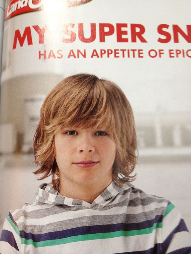 Cute boy's haircut....This is, evidently, the look Mannys going for.  Now if I could get him to brush his hair!