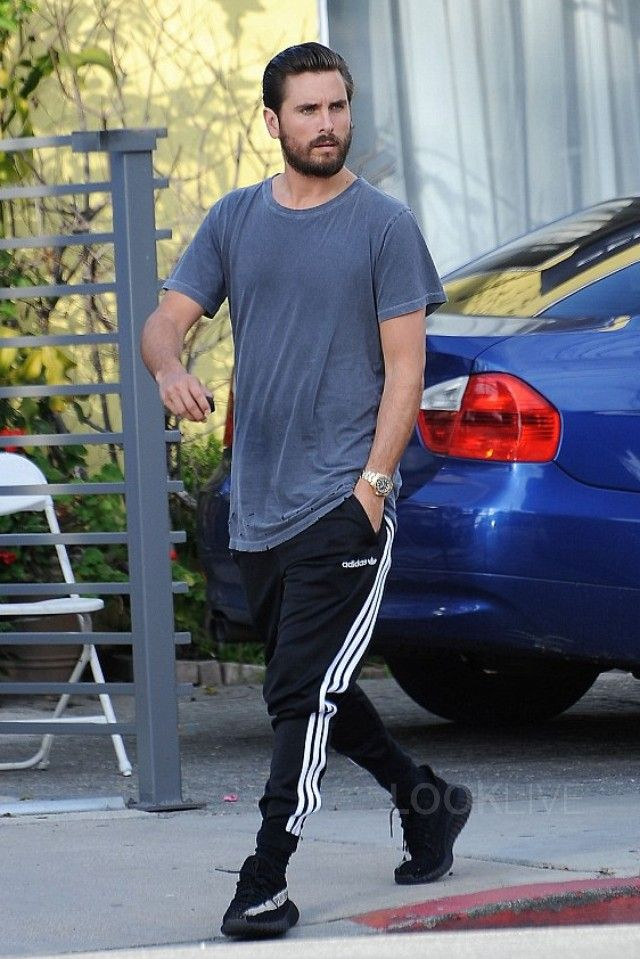 Scott Disick wearing Adidas Yeezy Boost 350 V2, Adidas UO Fitted Track Pant, John Elliott Washed Classic Crew T-Shirt