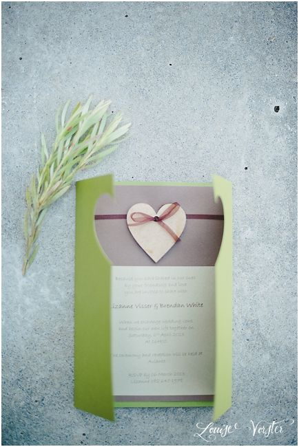 Green and brown invitation. Wooden heart can be seen when invitation is closed