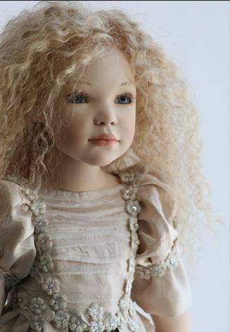 a repin of a doll by Zawieruszynski