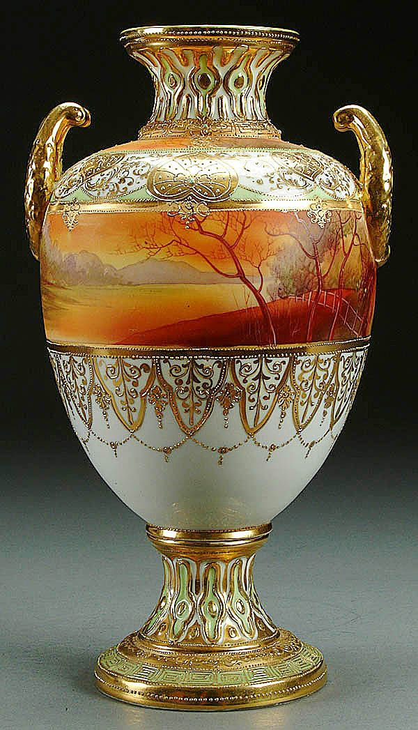 A NIPPON SCENIC PORCELAIN BOLTED URN CIRCA 1915 WITH A GALLE STYLE PAINTED SCENE BELOW A GILT AND JEWELED DECORATED SHOULDER