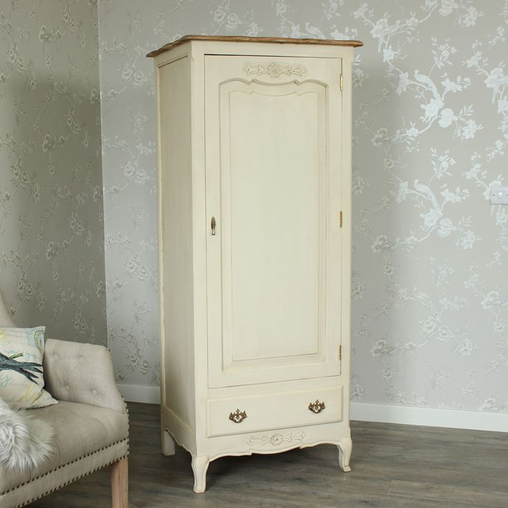 Normandy Range - Cream Single Wardrobe  Made from solid wood with a rich cream distressed painted finish  Single fronted door with beautiful carved flower detailing to the top  Inside there is a hanging rail and shelve for lots of storage  One large drawer to the bottom with fancy brass handles  www.melodymaison.co.uk