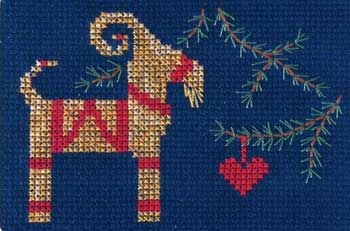 """Stitch the perfect card for your Scandinavian friends with this complete kit.  The Julbock or Christmas Goat is stitched on 14-count Navy Blue Aida.  The floss, needle, chart, and 5"""" x 7"""" white greeting card is included.  The card is blank inside."""