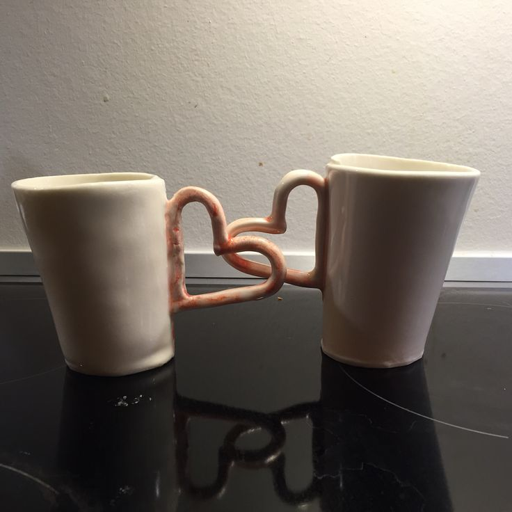 Ceramic cups with heart as handle