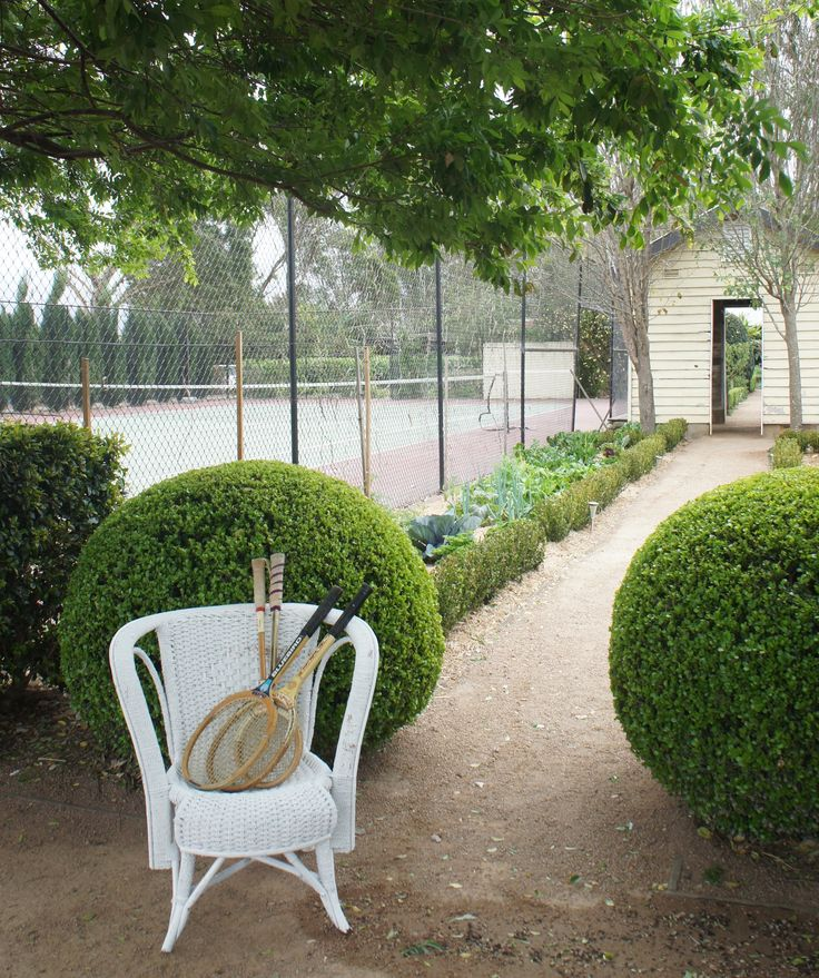 Anyone for tennis?  Very late Spring at Merribee under the Chinese Elms and in front of two very large buxus balls.  Heading through the vegetable garden to the milking shed.  www.merribee.com.au