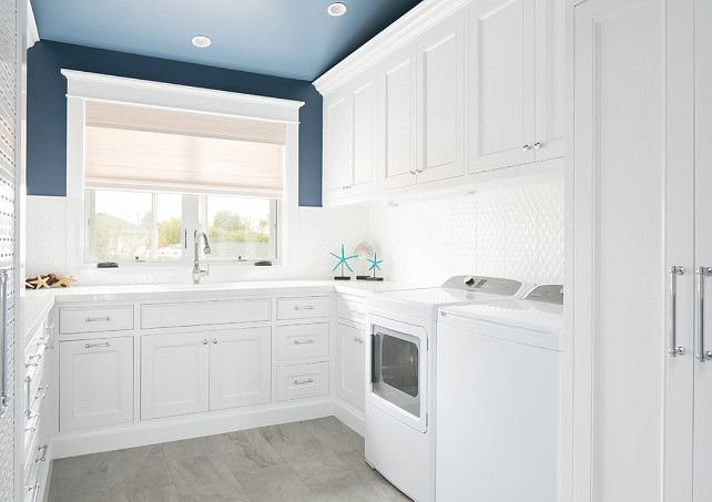 blue and white laundry room laundry room with white cabinets and blue paint on walls and. Black Bedroom Furniture Sets. Home Design Ideas