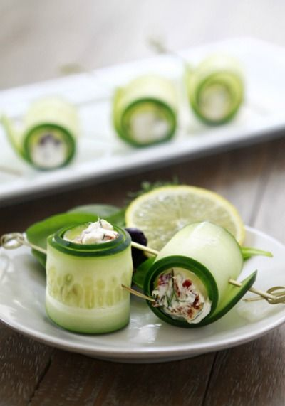 how cute are these cucumber feta rolls?thinly sliced cucumbers wrapped around feta, Greek yogurt, sundried tomatoes, chopped kalamata olives, dill, and lemon juice. Read More http://www.glamour.com/health-fitness/blogs/vitamin-g/2012/02/afternoon-snack-cucumber-feta.html#ixzz1nX2EVCBU