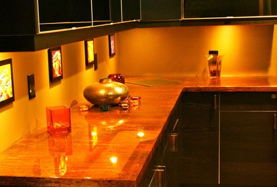 Enchantment Copper Counter-top with Black Wood Cabinets