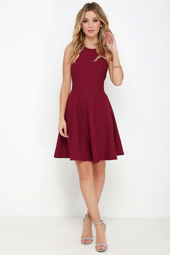 What's the perfect sweet treat to start off your week? How about the Now or Skater Burgundy Dress?! Poly-spandex stretch knit has a fun athletic-inspired look as it forms the sleeveless, racerback bodice complete with darted accents and a fitted waist. Hidden side seam pockets top off the darling skater skirt. Hidden back zipper.