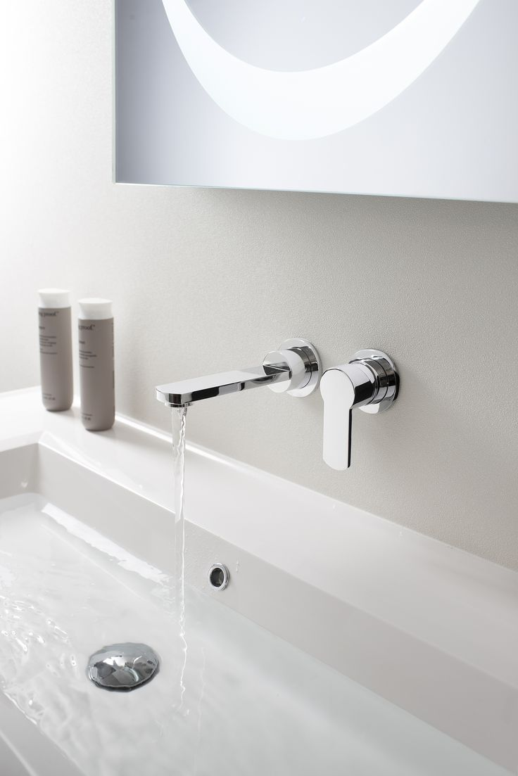 Basin up against wall. Taps in wall.  Tap Set from Crosswater http://www.crosswater.co.uk/product/wisp/wisp-basin-2-hole-set-wp120wnc/