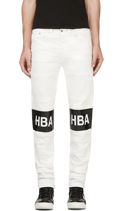 White Denim Logo Tarred Hockey Jeans exclusive for Ssense designed by Hood By Air. Slim-fit jeans in white. Seven-pocket styling. Silver-tone hardware throughout. D-rings at back pockets. Rubberized glossy logo print at front legs in black and white. Tonal stitching. Button fly. http://zocko.it/LD2mm