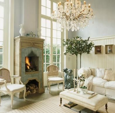 Beautiful Room- love the topiary, fireplace and chandelier !