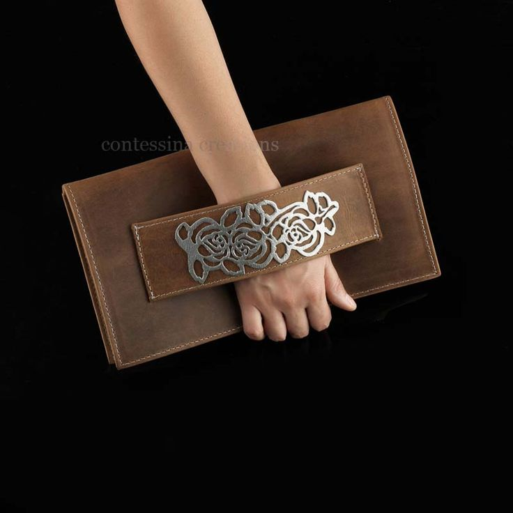 Handcrafted clutch leather collection by Contessina Exclusive Accessories, Athens. www.contessina.gr. Natural tanned cow leather with silver laser cut motif Available in wholesale and retail.