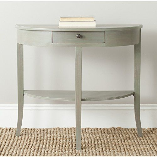 With clean lines inspired by Mission Style furniture, the transitional ash grey Alex console by Safavieh adapts to myriad decorating themes. Crafted of elm with a handy drawer and lower shelf, this demilune table is ideal in an entry hall or living room. Use the Alex console in pairs for a grand... more details available at https://furniture.bestselleroutlets.com/accent-furniture/sofa-console-tables/product-review-for-safavieh-american-home-collection-alex-french-grey-console