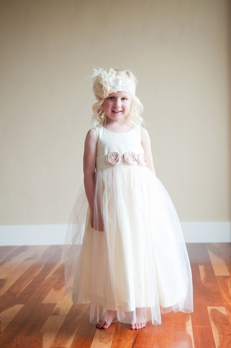 Hand-made to measure flower girl dress in ivory or white with blush pink flowers. All of our dresses are customisable and made in  London, UK by Gilly Gray  www.gillygray.com