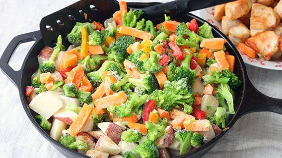 Frozen potatoes and vegetables in a skillet