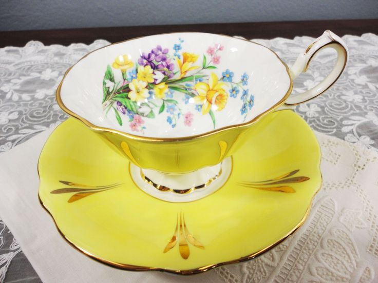 Rare Queen Anne Yellow Bone China Fluted Teacup and Saucer - Yellow Daffodils, Violets, Forget Me Not Flowers by AllDressedUpHome on Etsy https://www.etsy.com/listing/489438234/rare-queen-anne-yellow-bone-china-fluted