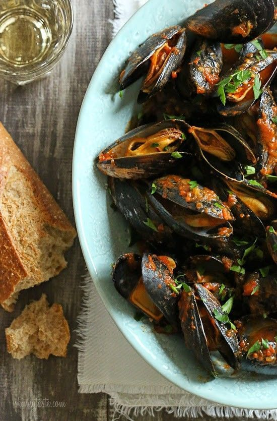Mussels in a spicy red marinara sauce – simple and elegant, best served with lots of whole wheat crusty bread for dipping into the delicious sauce. Seafood on Christmas Eve is a holiday family tradition. This can be served as an appetizer with bread for dipping or over pasta as a main dish or even over zoodles to keep it low carb. I usually use my own homemade marinara sauce (I never use jarred sauce) when I make this, but I tried this with Delallo's Pomodoro Fresco and I have to say I w...