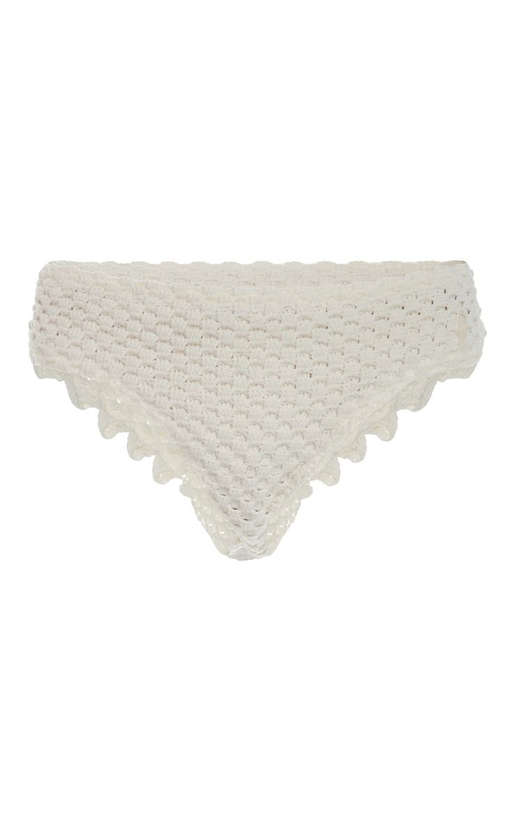 Helen Rödel Crochet-Knit Bikini Briefs €300 Helen Rödel's bikini bottoms are crafted from ivory crochet-knit. They're designed with a mid-rise waist and edged with scalloped trims. Complete a pretty set with the matching triangle top.     Pull on     Composition: 100% polyamide     Hand wash