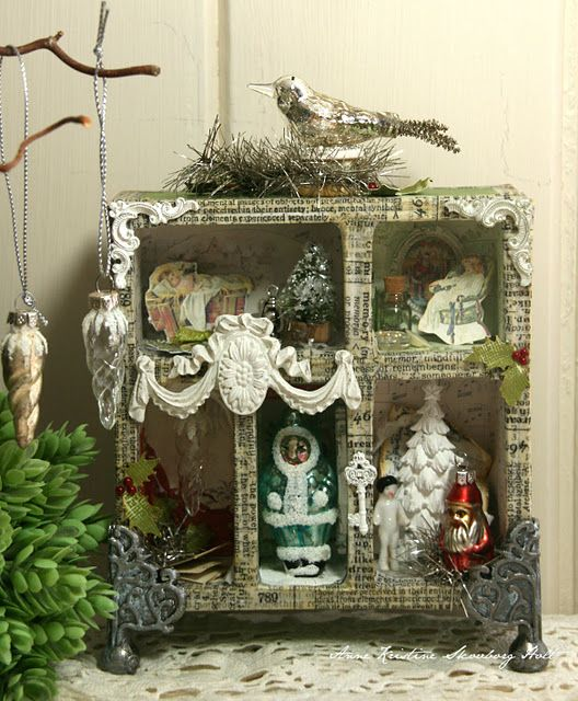 I like the idea of using an old Christmas story to cover the shelf, cover it in glitter, and use old fashioned ornaments and decorations for it